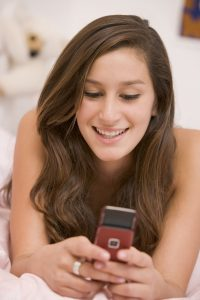 teenage girl using mobile phone